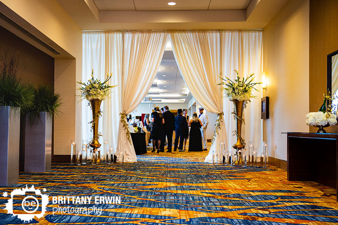 Downtown-Indianapolis-JW-Marriott-event-photographer-entry-curtain-classy-gold-vase-piece.jpg