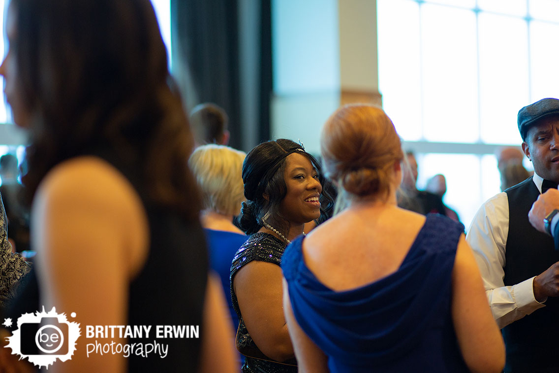 Indianapolis-event-photographer-cocktail-hour-group-chatting-in-hall-at-JW-Marriott.jpg