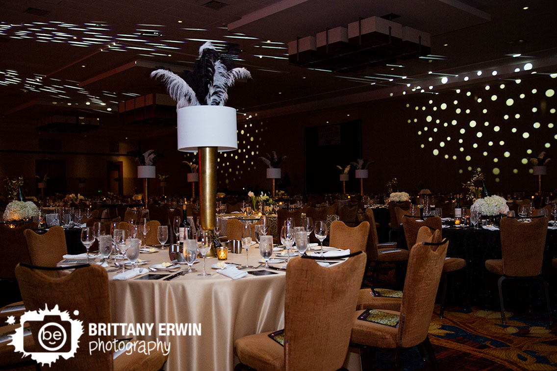 Gatsby-era-inspired-ball-at-Indianapolis-downtown-JW-Marriott-ball-room-feather-tall-centerpiece-light-show.jpg