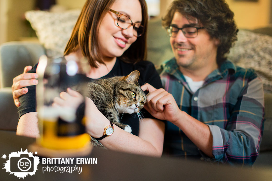 Indianapolis-engagement-portrait-photographer-lifestyle-session-with-pet-cat-couple-cuddle.jpg