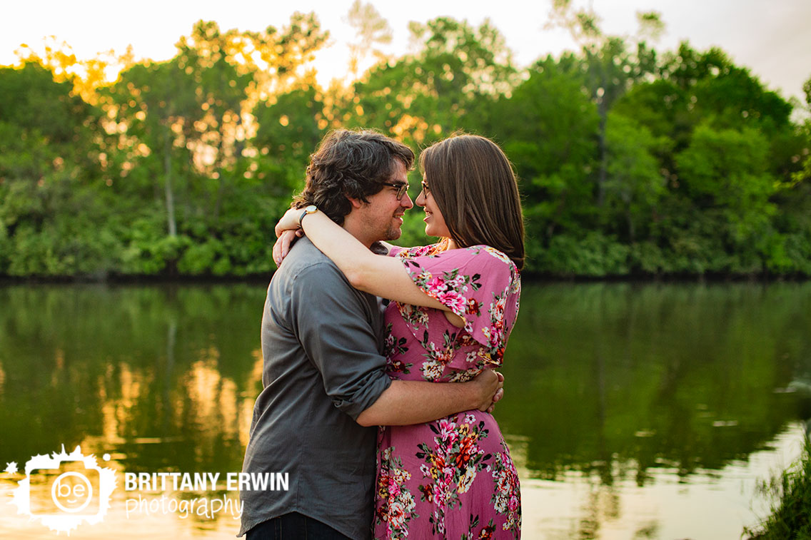 Broad-Ripple-park-engagement-portrait-photographer-couple-by-water-at-sunset.jpg