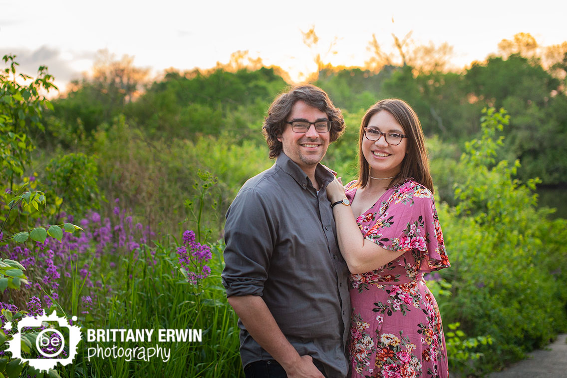Broad-Ripple-Indiana-engagement-portrait-photographer-couple-at-park-with-purple-flowers-sunset.jpg