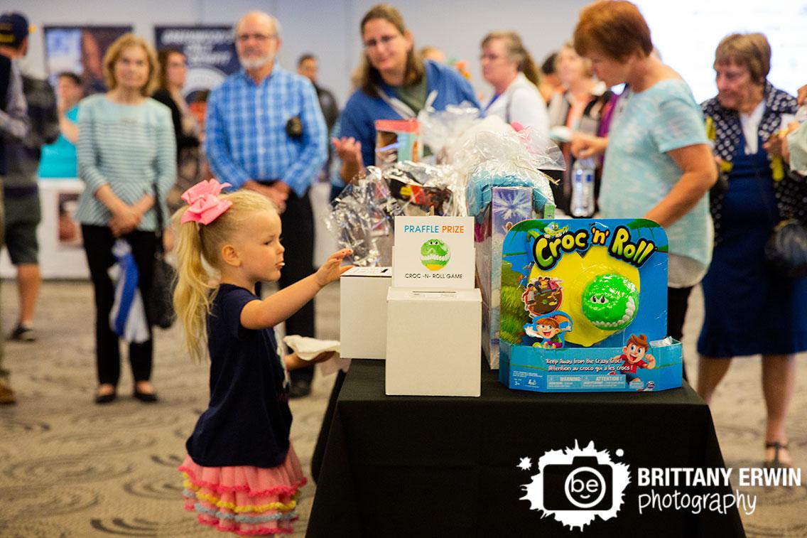 Indianapolis-event-photographer-praffle-raffle-box-little-girl-entering-to-win.jpg