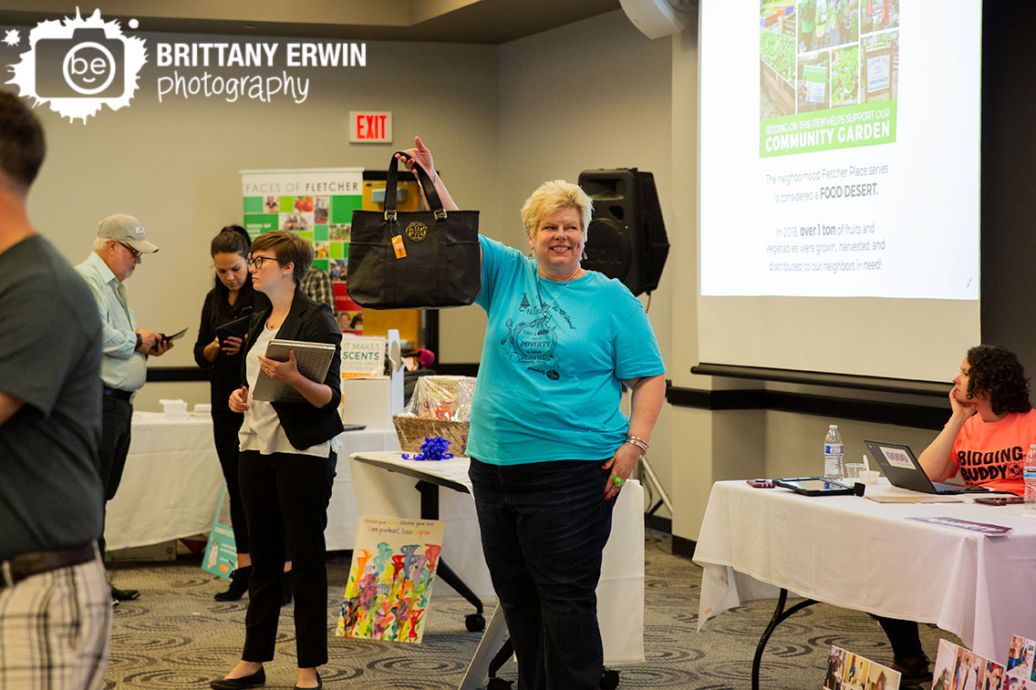 Indianapolis-event-photographer-live-auction-purse-fletcher-place-community-center-fundraiser.jpg