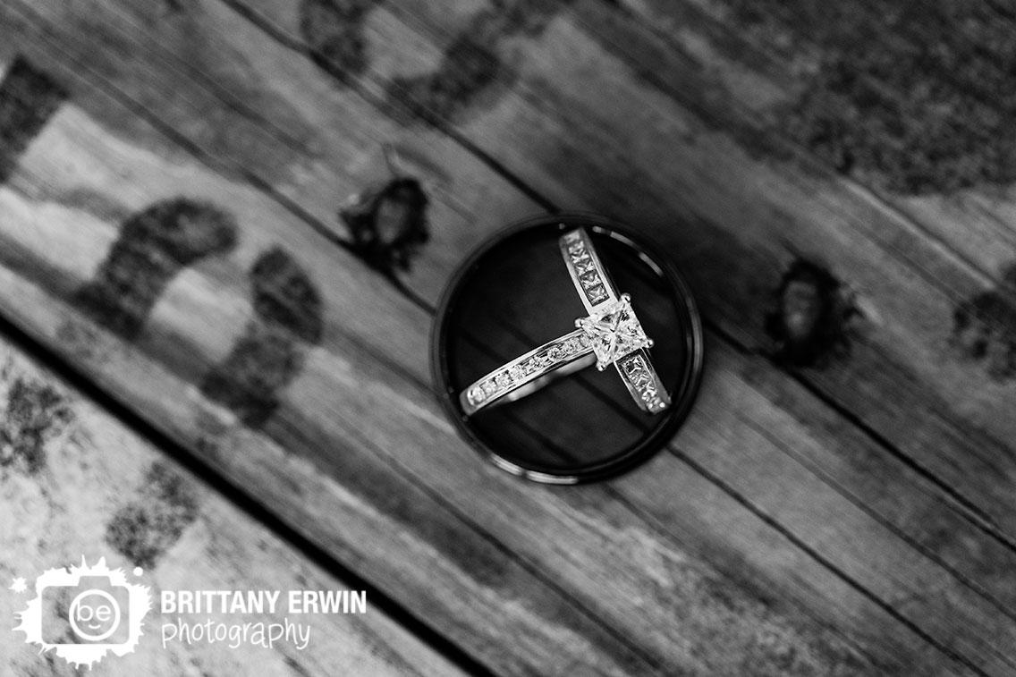 bride-rings-enagement-wedding-band-resting-inside-groom-ring.jpg