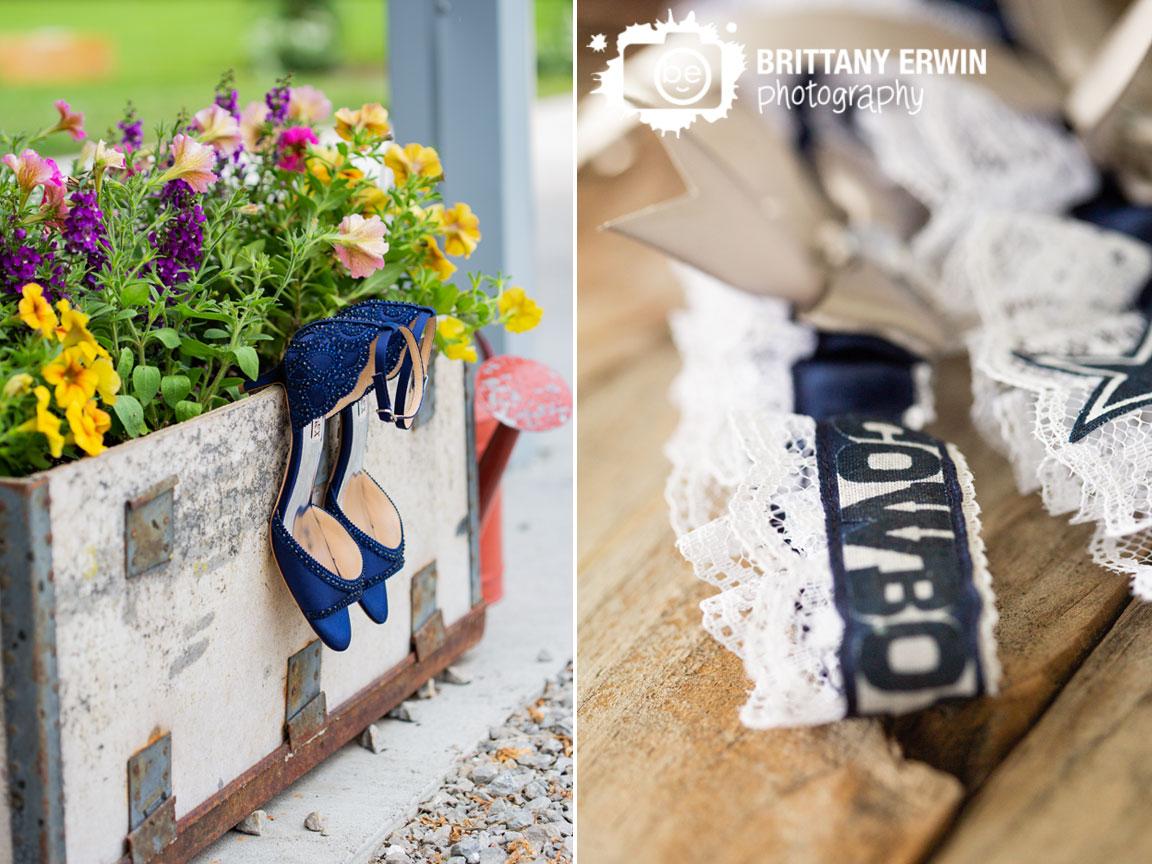 bride-details-shoes-garter-on-flower-box.jpg