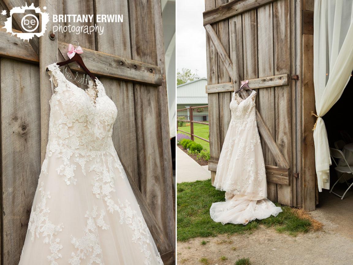 bridal-gown-hanging-on-barn-door-open-wedding-photographer-custom-hanger.jpg