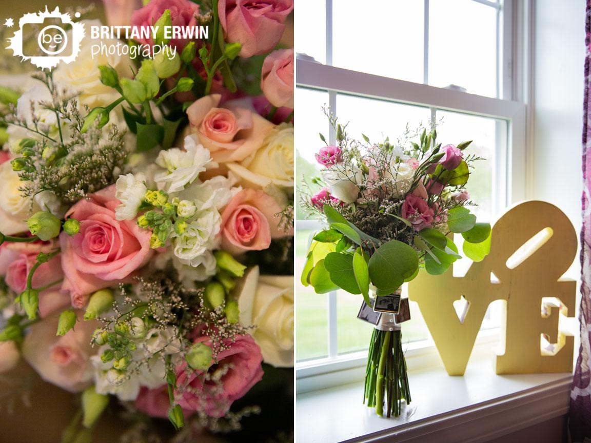 bride-bouquet-in-window-love-sculpture-roses.jpg