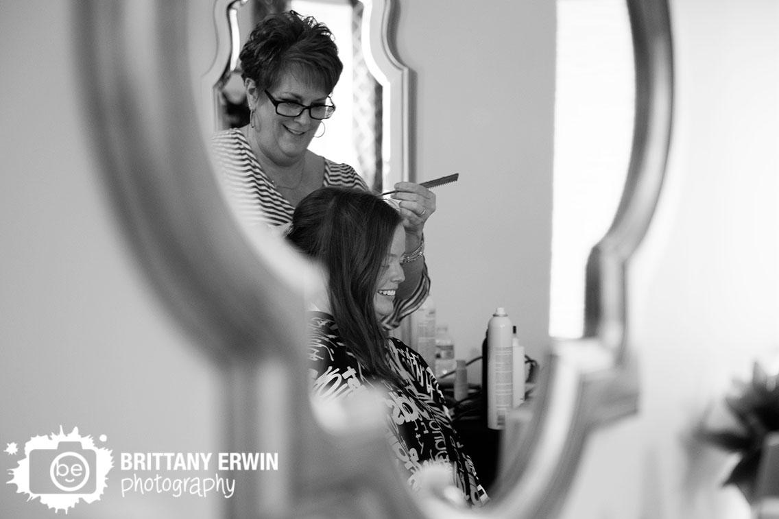 wedding-photographer-bride-having-hair-done-in-mirror.jpg