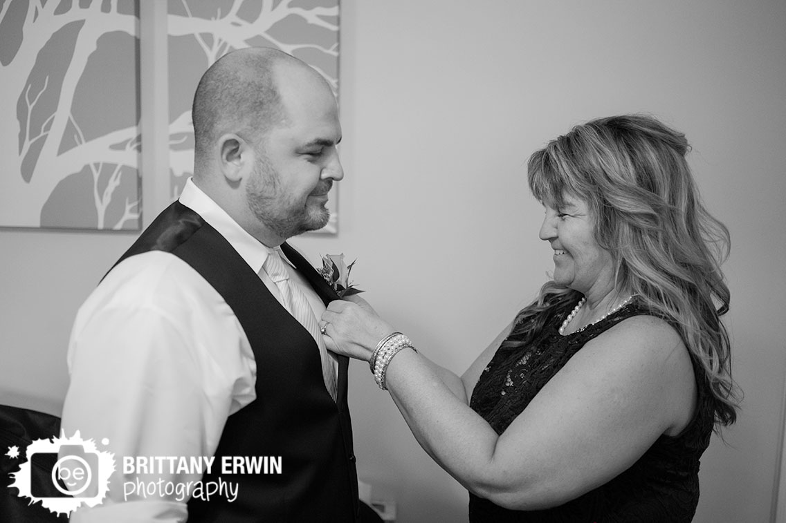 Mother-of-groom-pinning-on-boutonniere.jpg