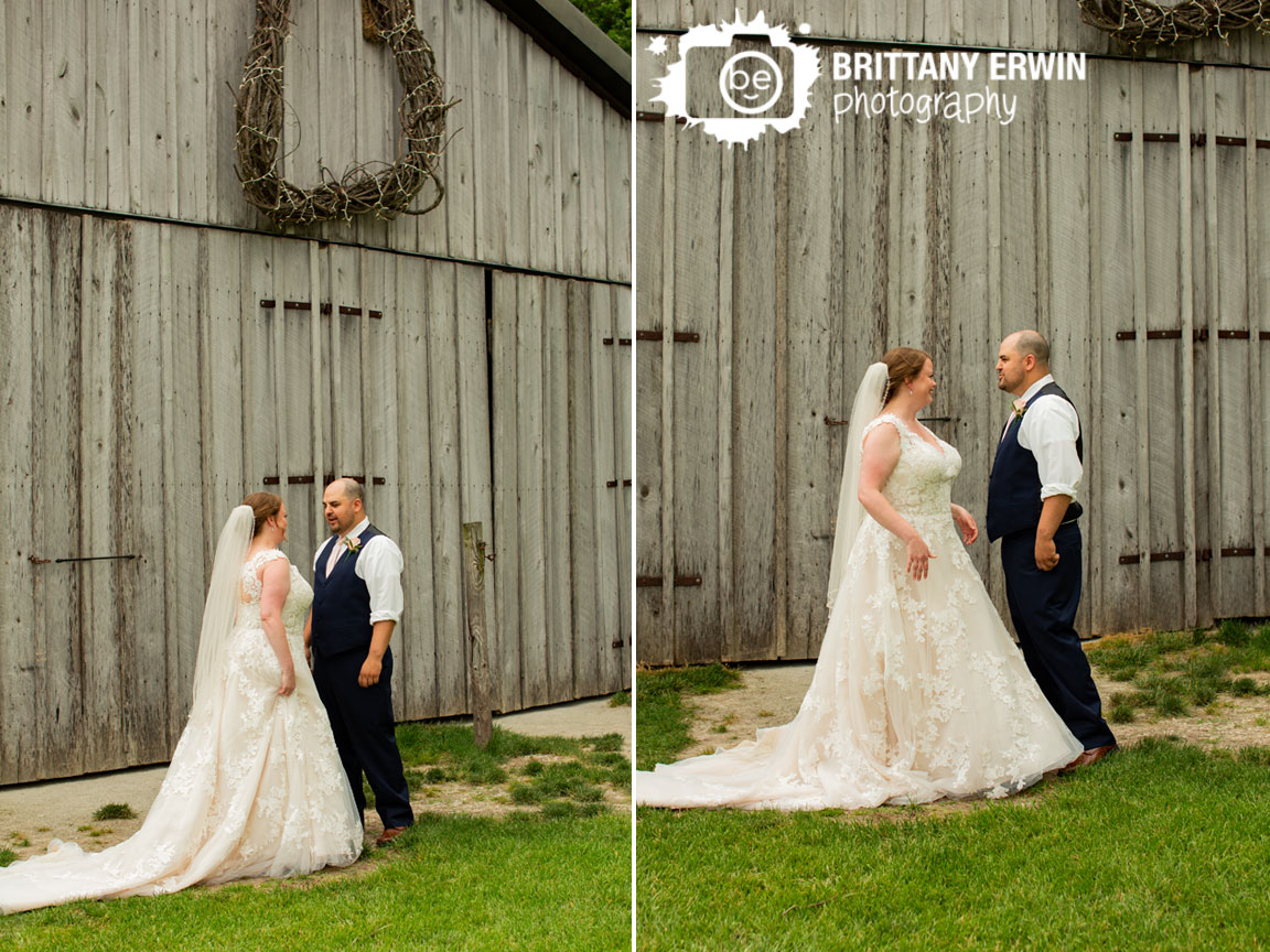 First-look-wedding-photographer-couple-in-front-of-barn-at-Hidden-Brook-Acres.jpg