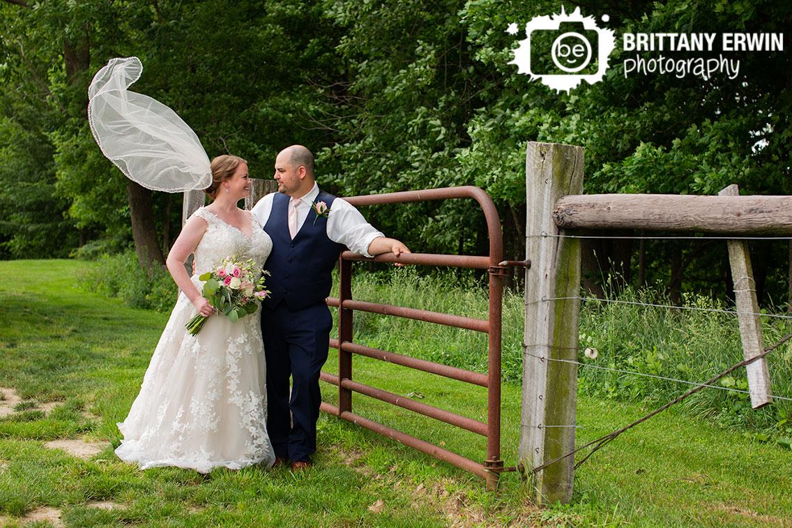 Shelbyville-Hidden-Brook-Acres-wedding-photographer-couple-at-gate.jpg