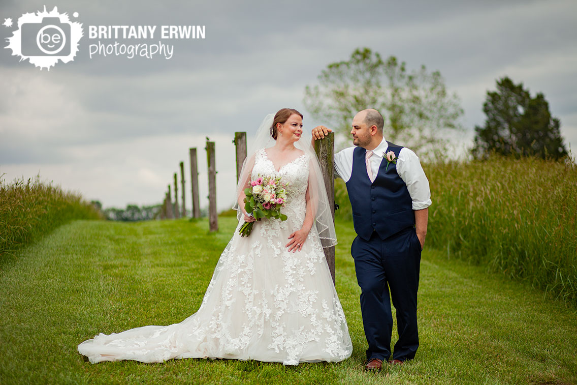 Shelbyville-Indiana-wedding-photographer-couple-on-fence-path-bride-groom-portrait.jpg
