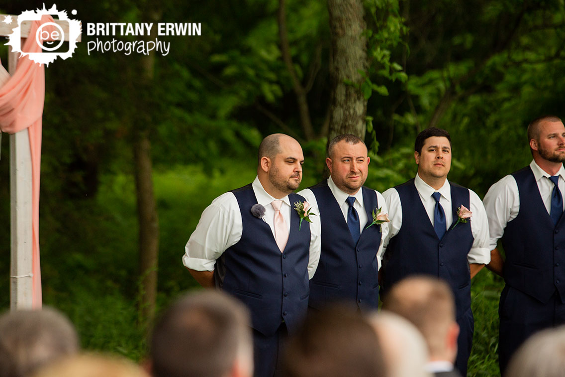 groom-at-altar-waiting-for-bride-at-ceremony.jpg