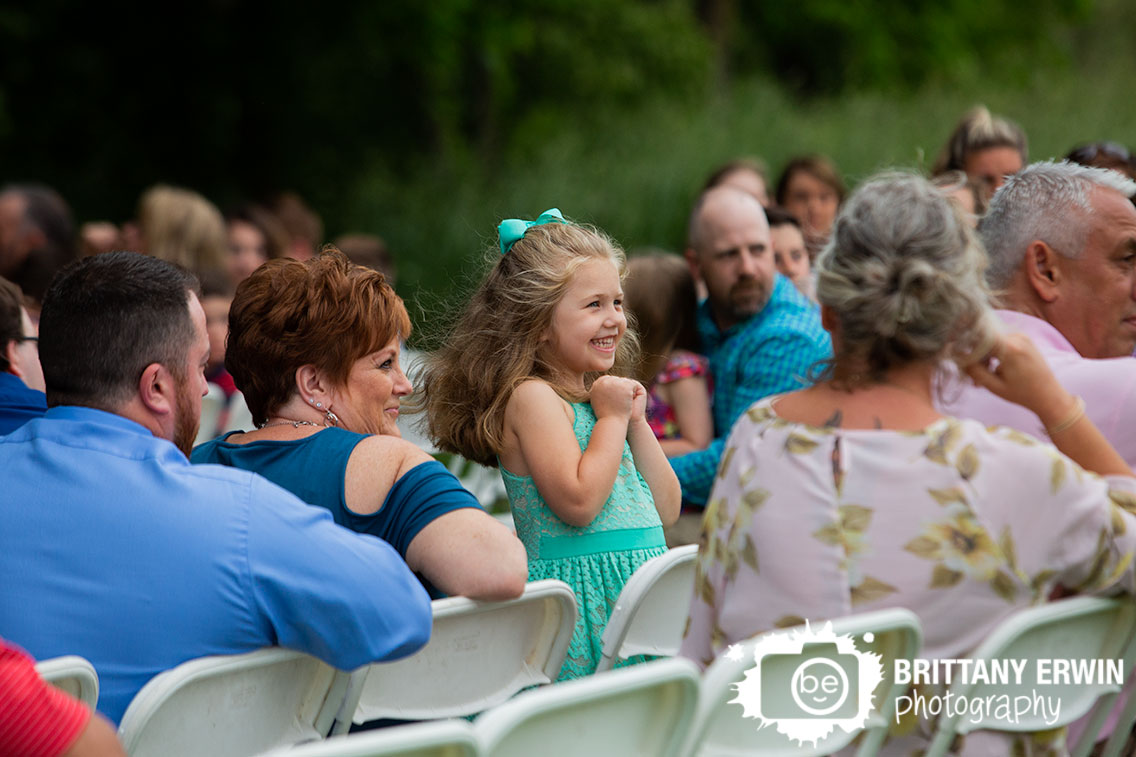 little-girl-in-seats-excited-at-wedding-ceremony.jpg