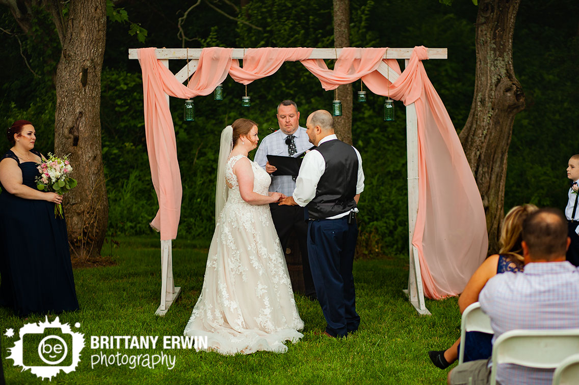 wedding-ceremony-ring-exchange-outdoor-pink-drapery.jpg