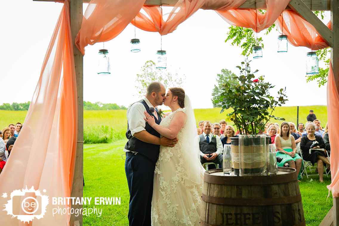 Shelbyville-Indiana-outdoor-summer-wedding-ceremony-first-kiss.jpg