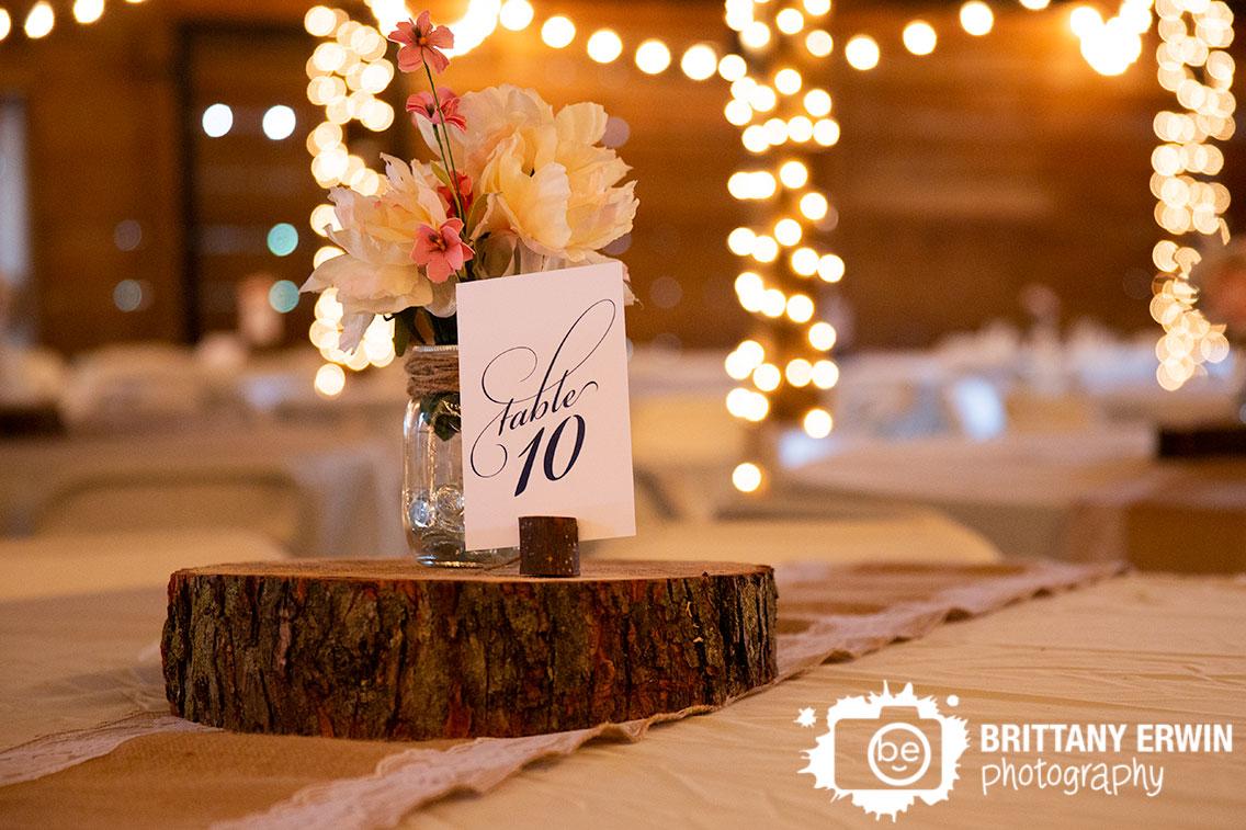 table-number-flower-centerpiece-twinkle-lights-barn-venue.jpg