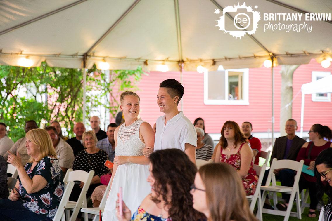 Indianapolis-wedding-photographer-brides-couple-walk-down-aisle-together.jpg