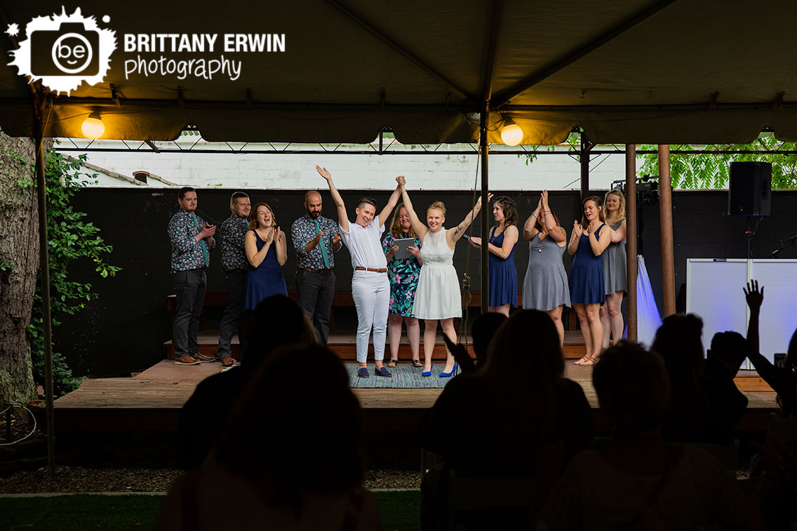 wedding-ceremony-announced-wife-and-wife-couple-cheer.jpg