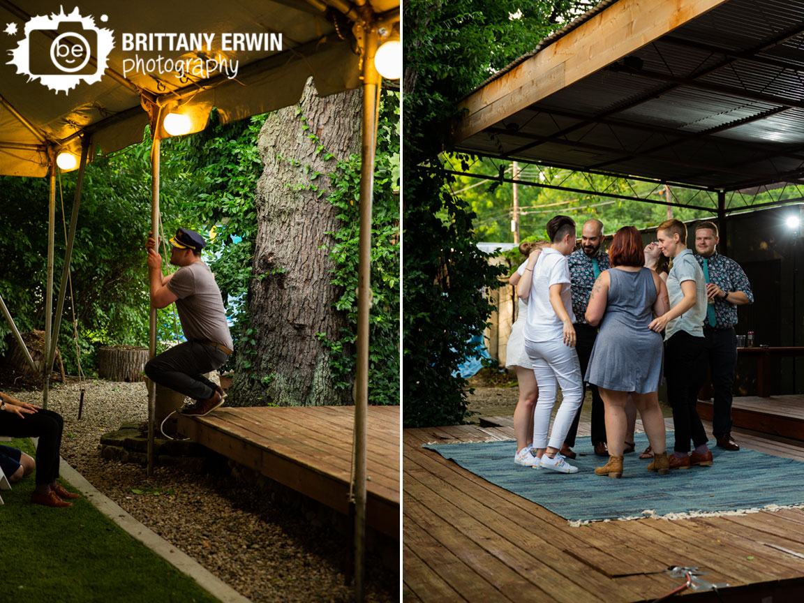 Groomsman-swinging-on-tent-pole.jpg