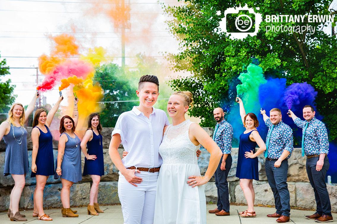 Broad-Ripple-Indiana-gay-pride-month-rainbow-smoke-bomb-bridal-party-wedding-photographer-couple-on-path.jpg