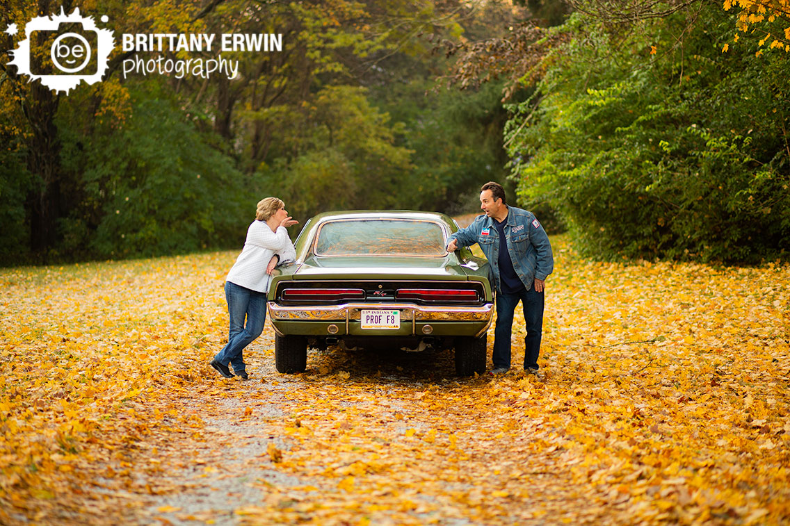 Indianapolis-portrait-photographer-fall-leaves-gravel-drive-blowing-kiss.jpg