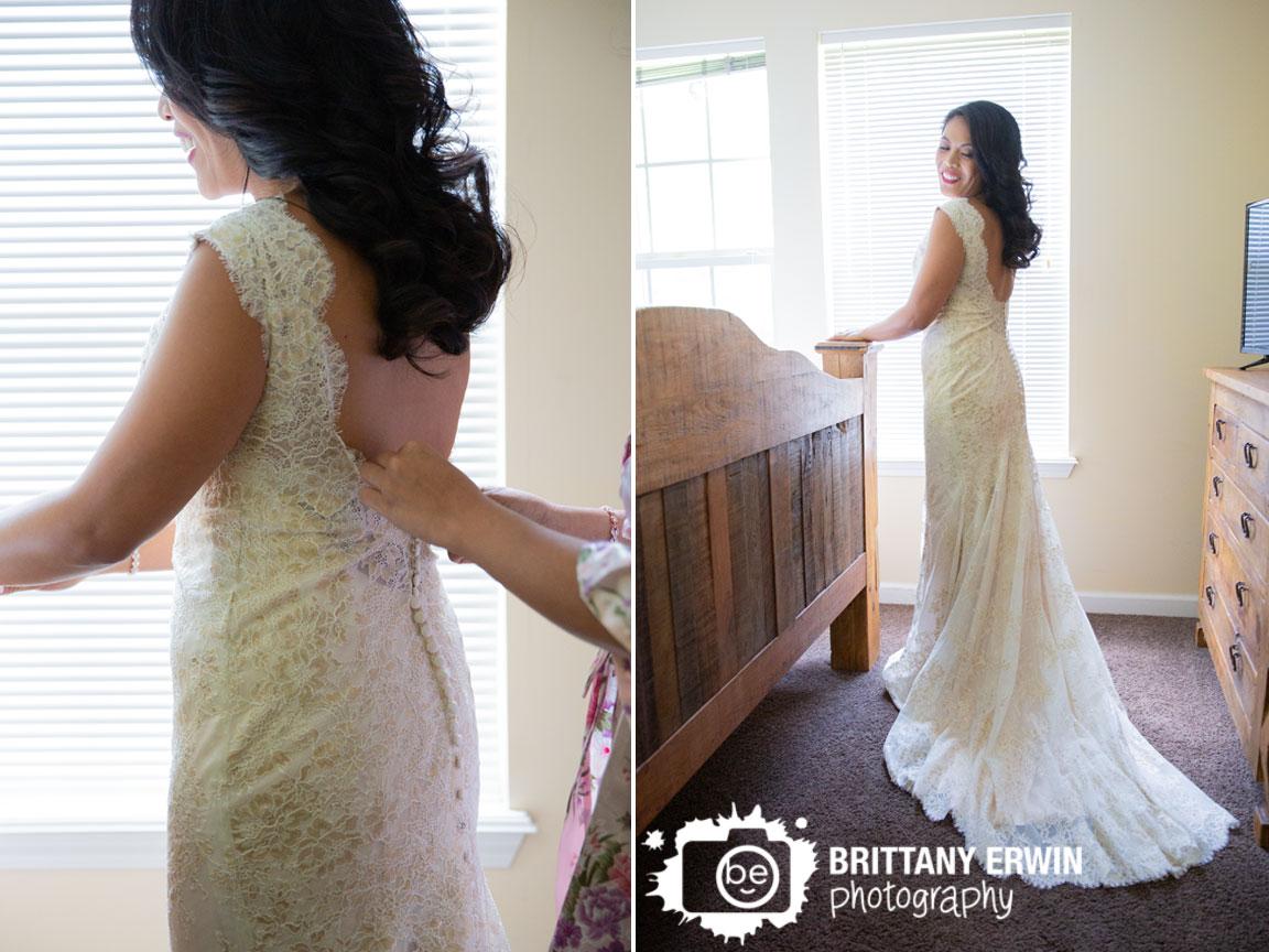 bride-getting-ready-button-back-dress-salt-creek-golf-resort.jpg