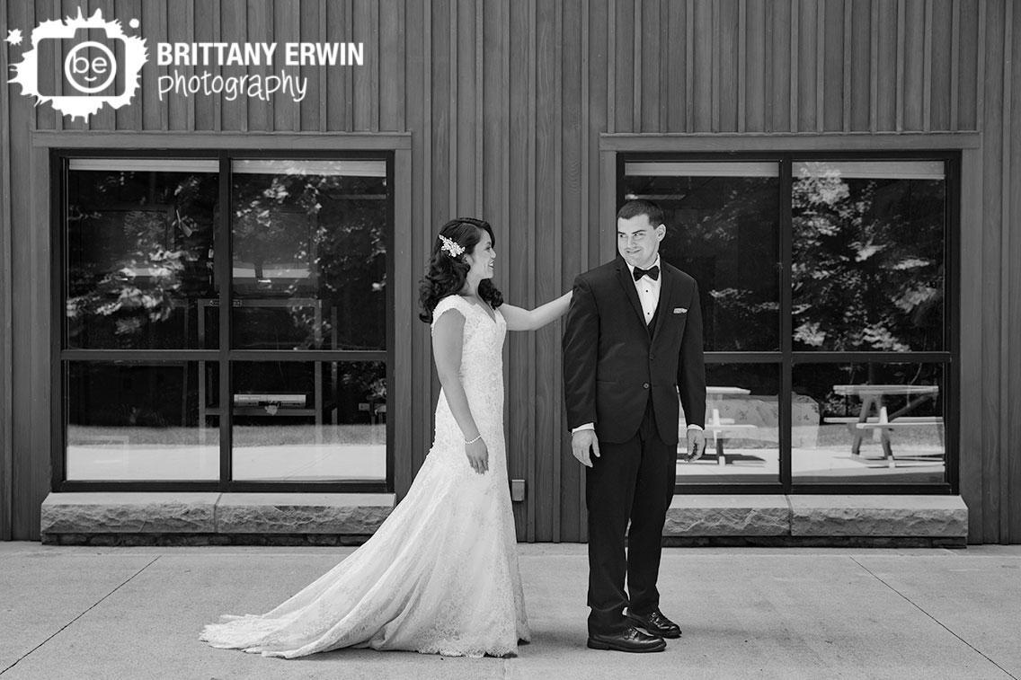 first-look-portrait-bride-tap-groom-on-shoulder-outdoor.jpg