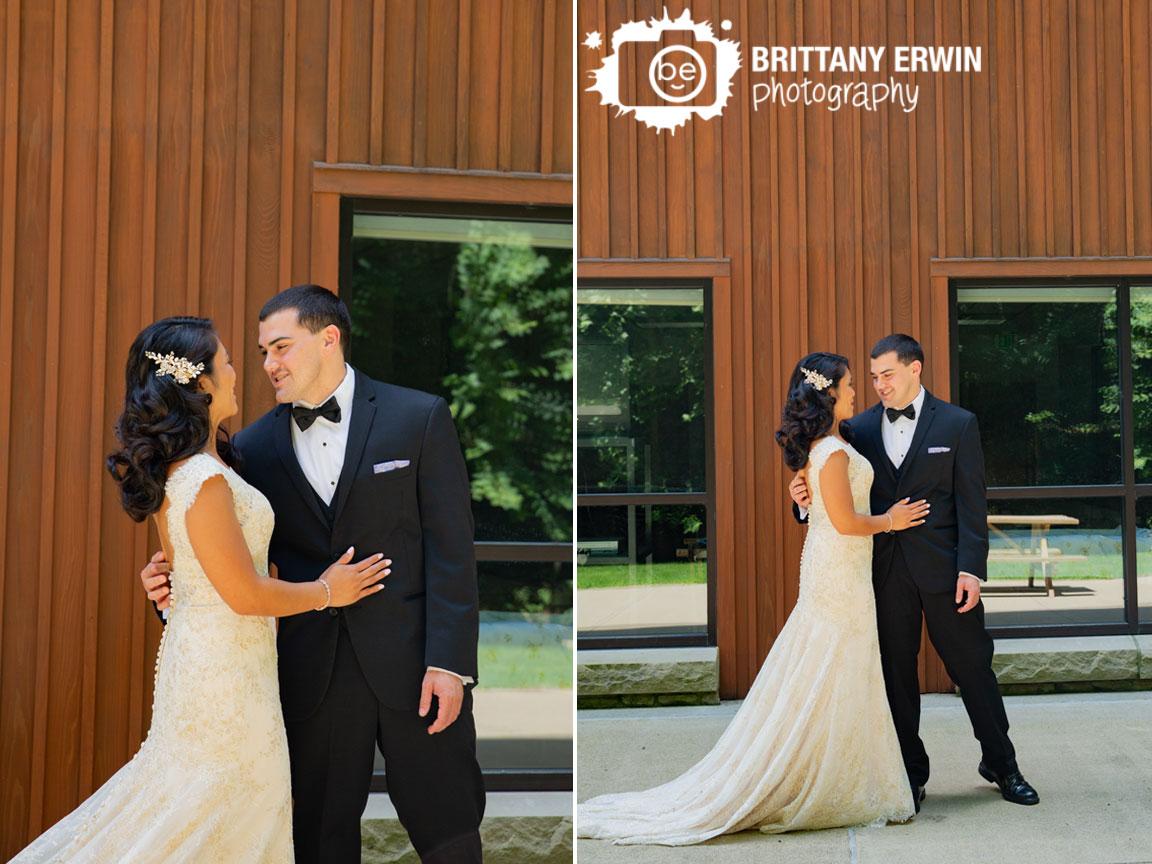 first-look-portrait-groom-reaction-outside-couple.jpg