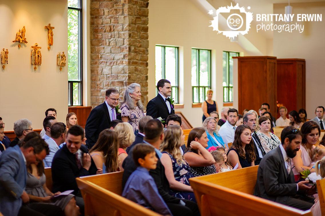 St-Agnes-Catholic-Church-wedding-ceremony-photographer-groom-walking-with-parents.jpg