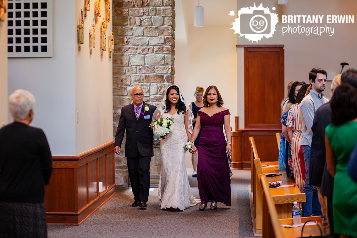 bride-walking-down-aisle-with-father-and-mother-st-agnes-catholic-church.jpg