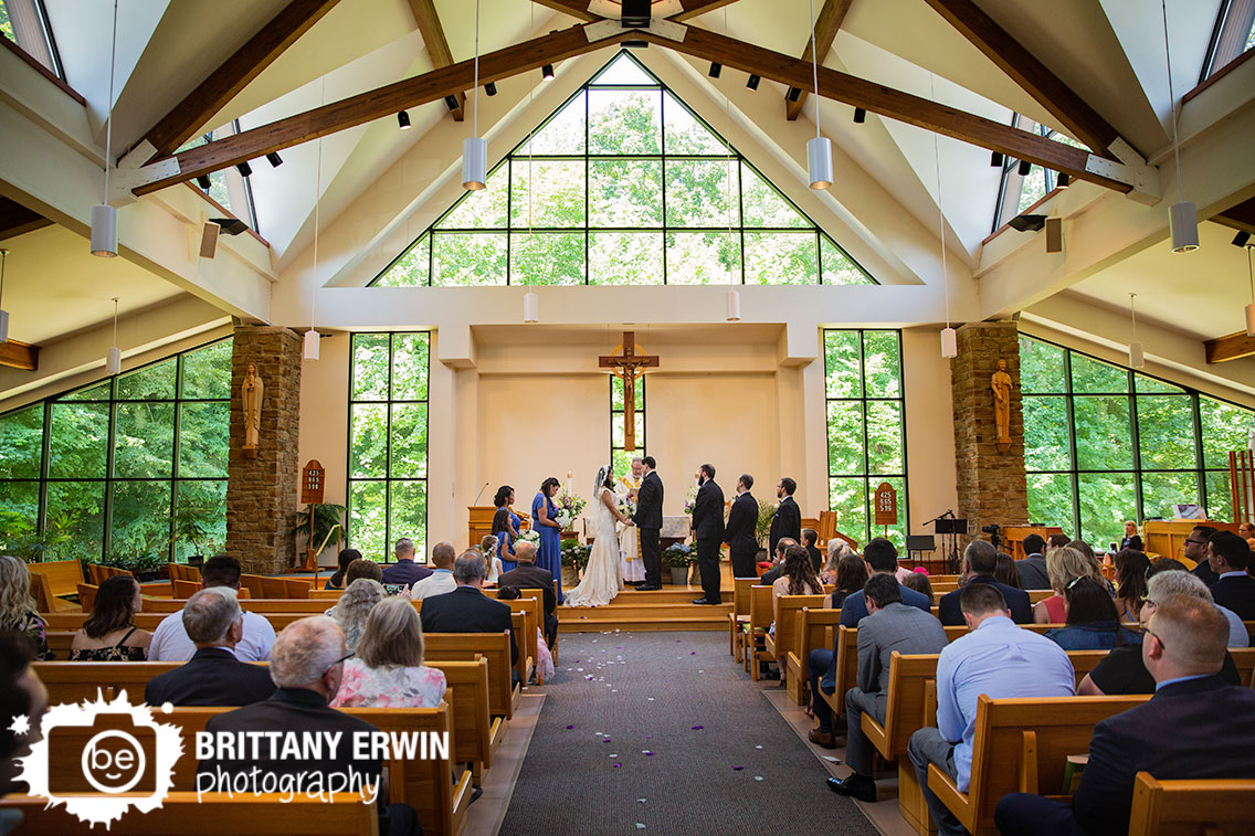 Indiana-wedding-ceremony-photographer-bridal-party-at-altar-couple-holding-hands.jpg