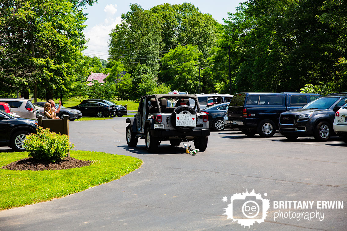 just-married-jeep-with-cans-tied-to-back-getaway-vehicle.jpg