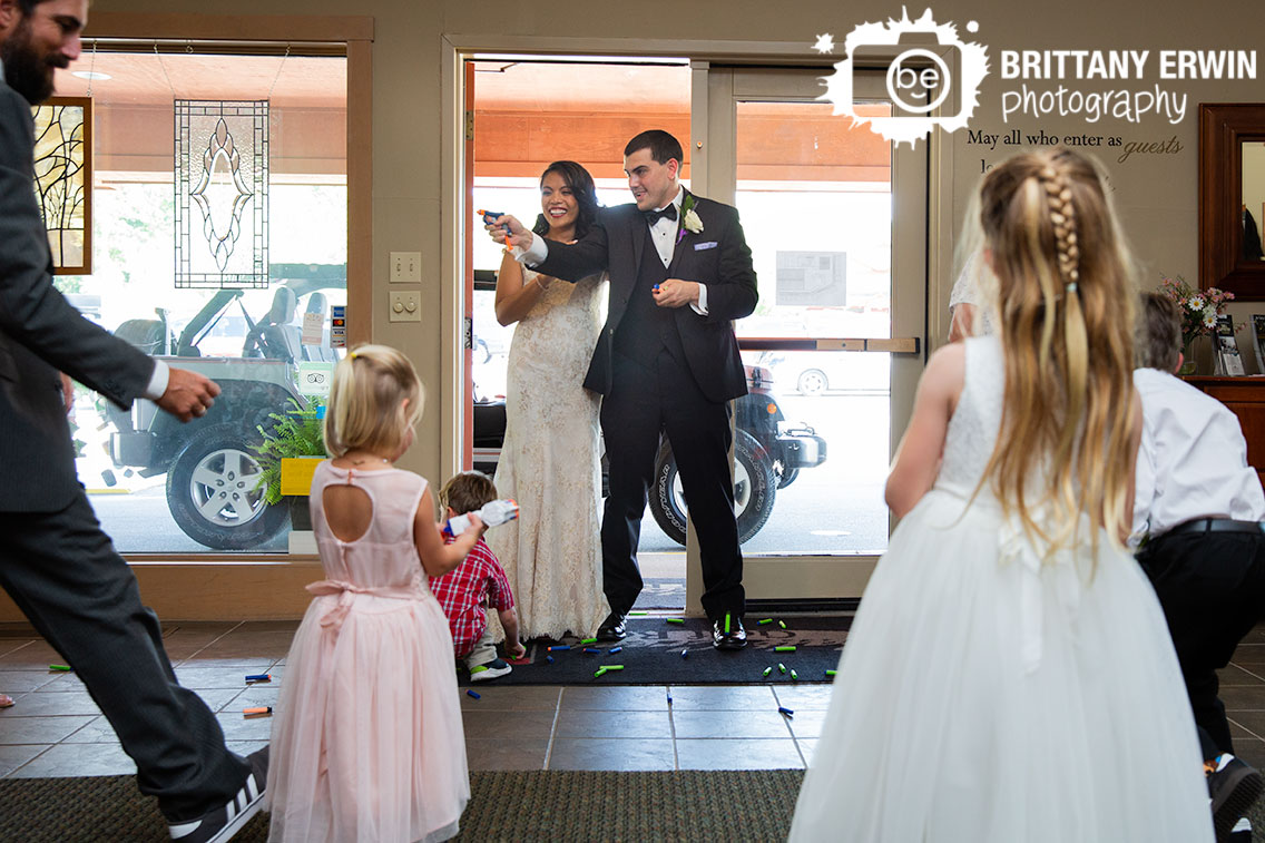 bride-and-groom-enter-reception-nerf-guns-with-kids.jpg