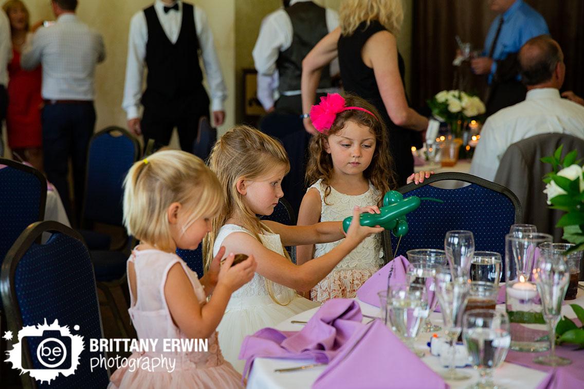 flower-girl-making-balloon-animals-at-wedding-reception.jpg