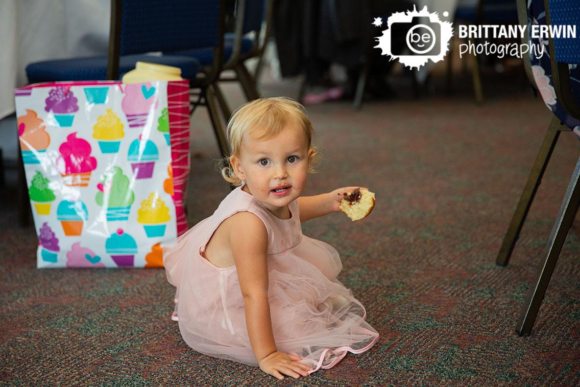 little-girl-eating-donut-messy-face-wedding-reception.jpg
