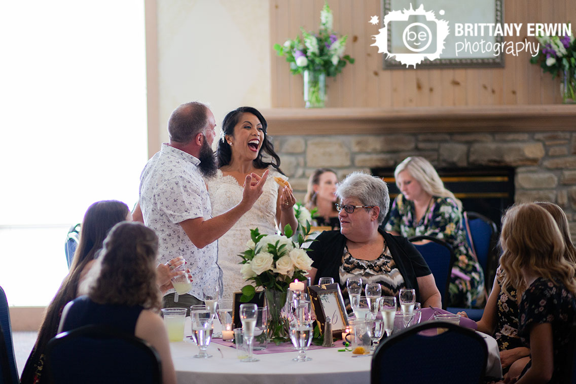 bride-laughing-with-donut-during-wedding-reception.jpg
