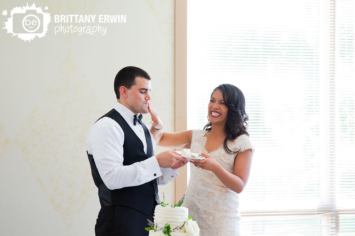 Wedding-photographer-reception-bride-groom-cut-cake-icing-on-face.jpg