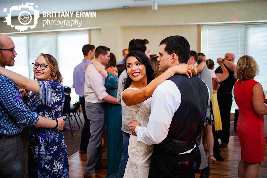bride-groom-dancing-on-dance-floor-wedding-reception.jpg