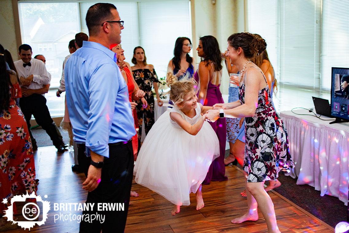 flower-girl-jumping-on-dance-floor-wedding-photographer.jpg