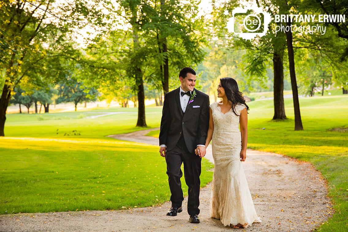 bride-groom-walk-down-path-sunset-Salt-Creek-Golf-Resort.jpg