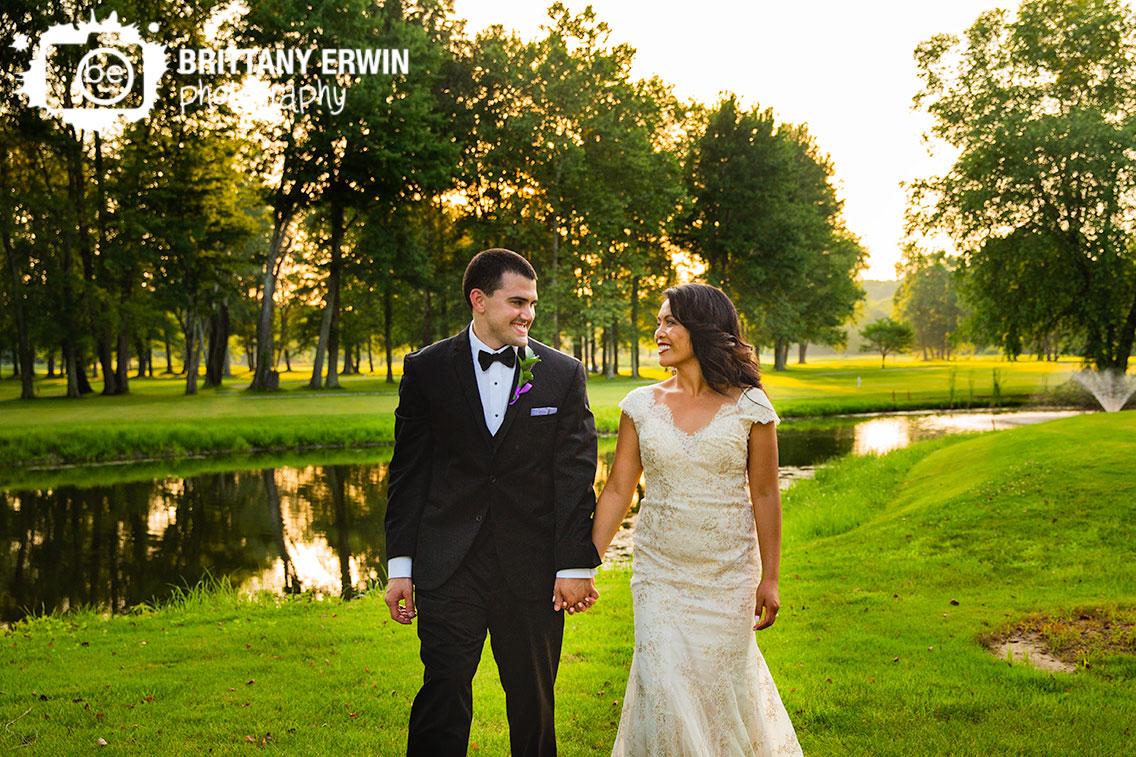 couple-walking-at-sunset-near-pond-salt-creek-golf-resort.jpg