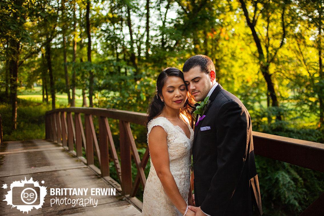 Nashville-Indiana-wedding-photographer-couple-at-sunset-on-bridge.jpg