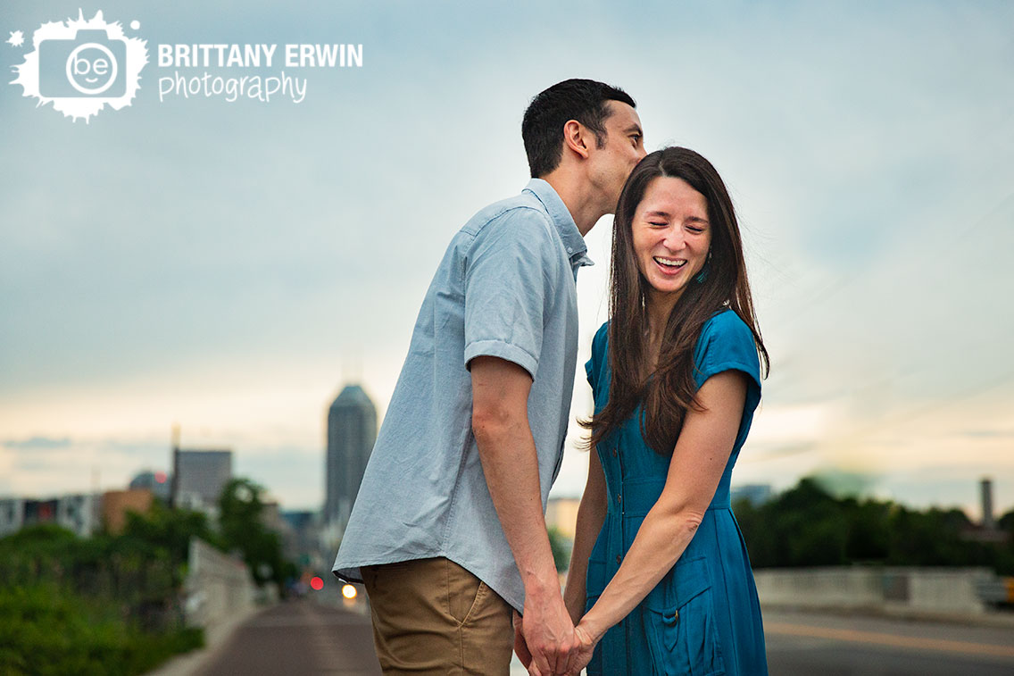 Fountain-Square-Indiana-engagement-portrait-photographer-laughing-kiss.jpg