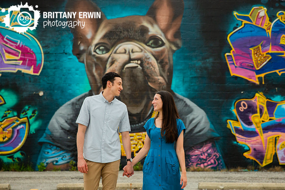 Indiana-engagement-portrait-photographer-couple-walking-dog-mural-fountain-square.jpg