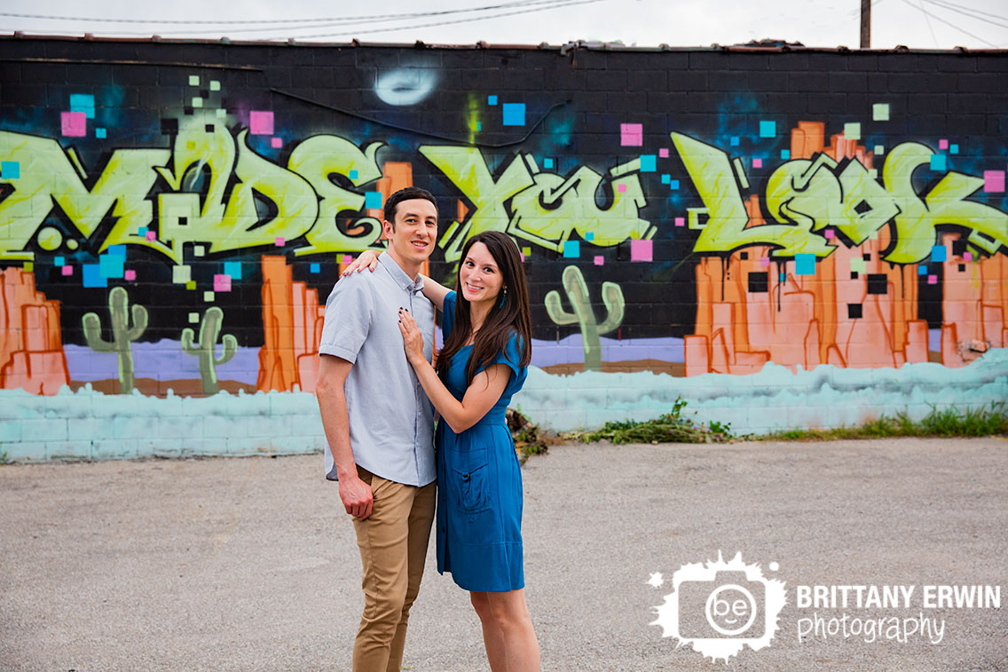 Fountain-Square-engagement-portrait-photographer-made-you-look-mural-couple-outdoor.jpg