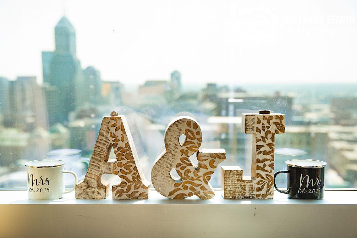 monogram-letters-mr-mrs-est-metal-mugs-ring-in-window-Indianapolis-skyline.jpg