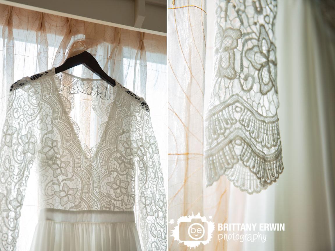custom-hanger-bride-bridal-gown-dress-in-window-lace-sleeves.jpg