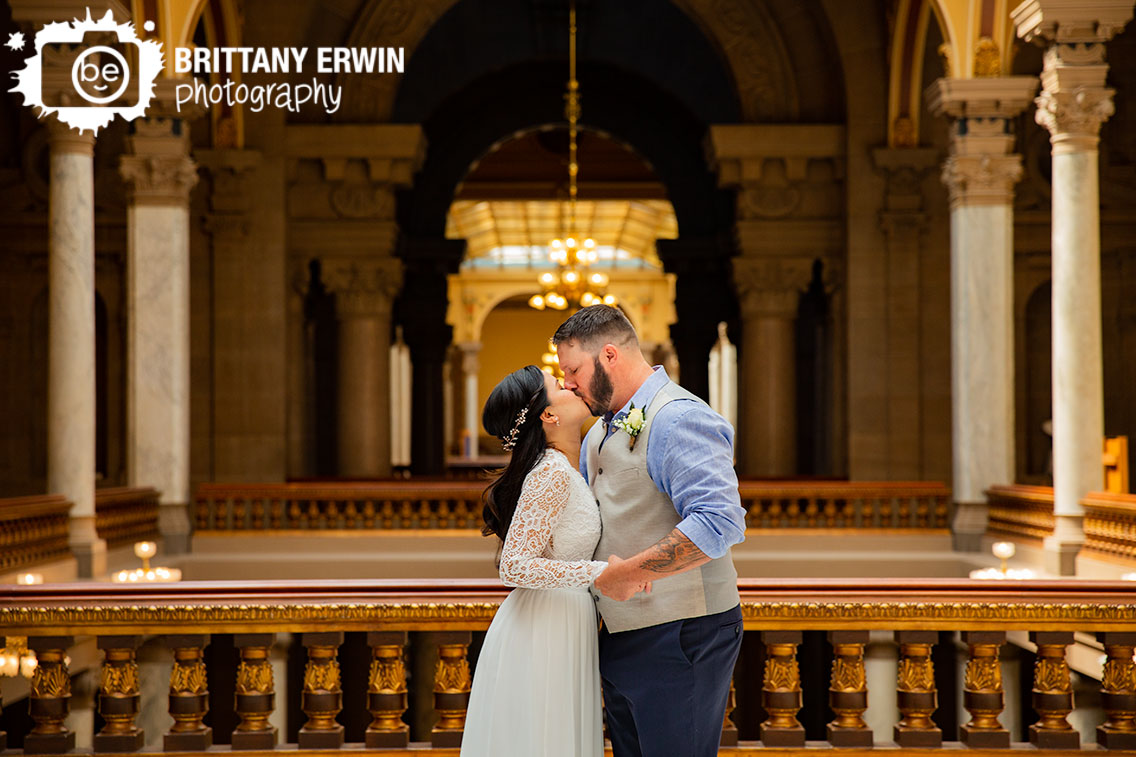 Indianapolis-elopement-photographer-ceremony-at-state-house-first-kiss-husband-and-wife.jpg